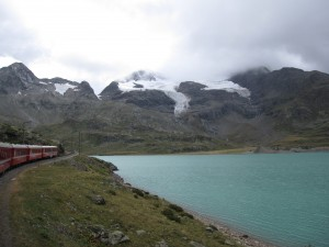 The glacier and silty-blue lake at the top of the Bernina pass.