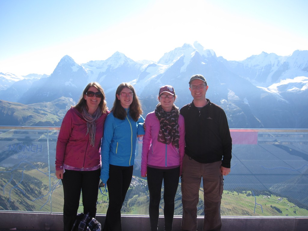 A bright and sunny morning at the Birg viewpoint on the way to the Schilthorn. The mountains in the background are three famous peaks in this region of Switzerland: the Eiger, the Mönch, and the Jungfrau.